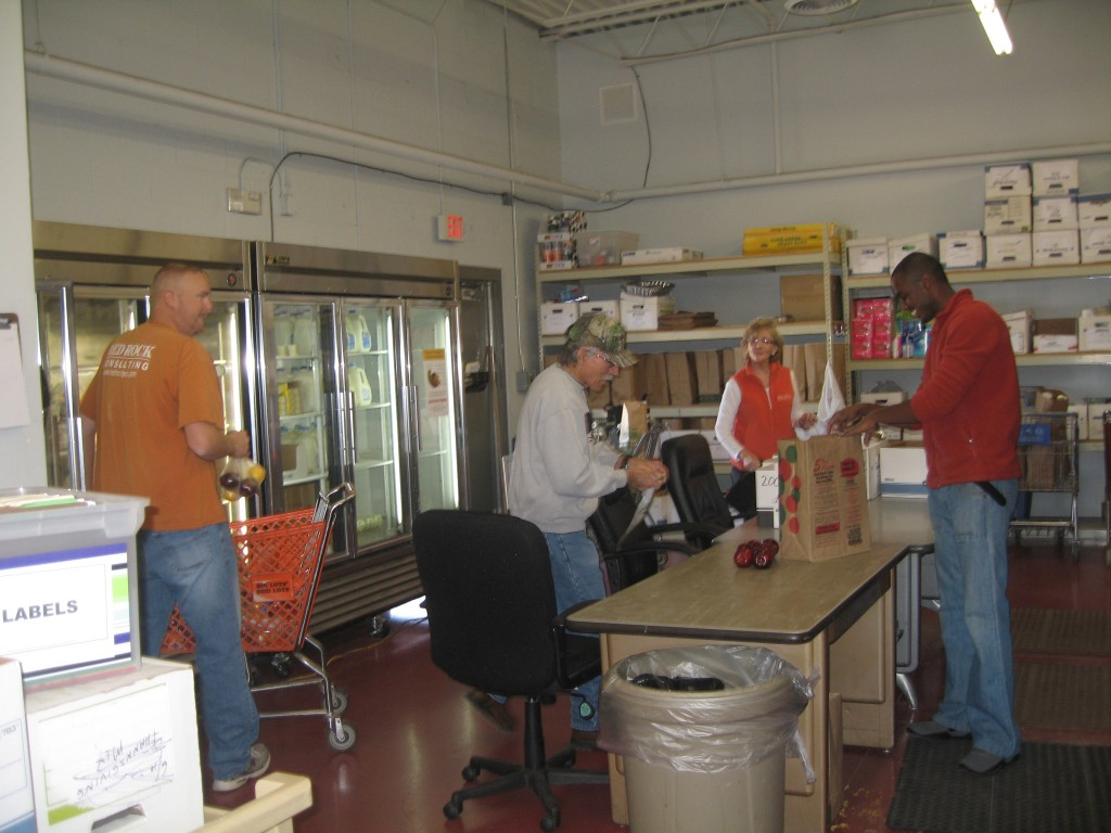 RRCc employees help stock food at the Hope Center